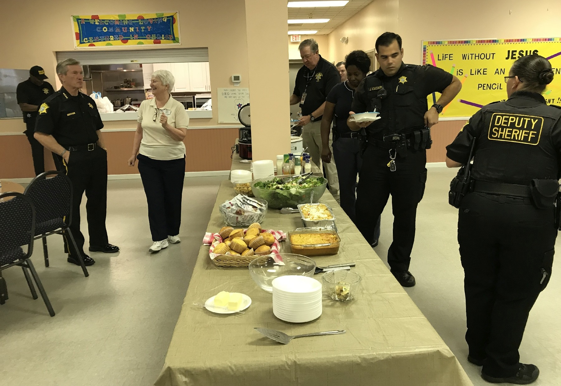 First Responders Seheriff Lott and Mary talking as the buffet opens to deputy wheriffs 3588