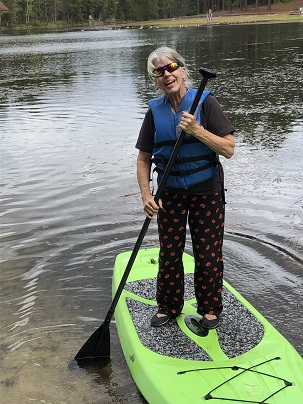 Ann on a paddle board.