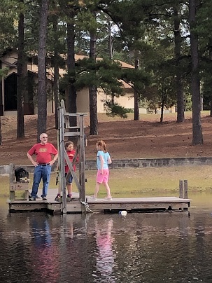Ray and kids on the dock.